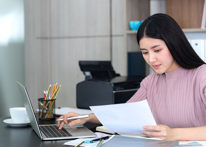 image of a woman looking at a report