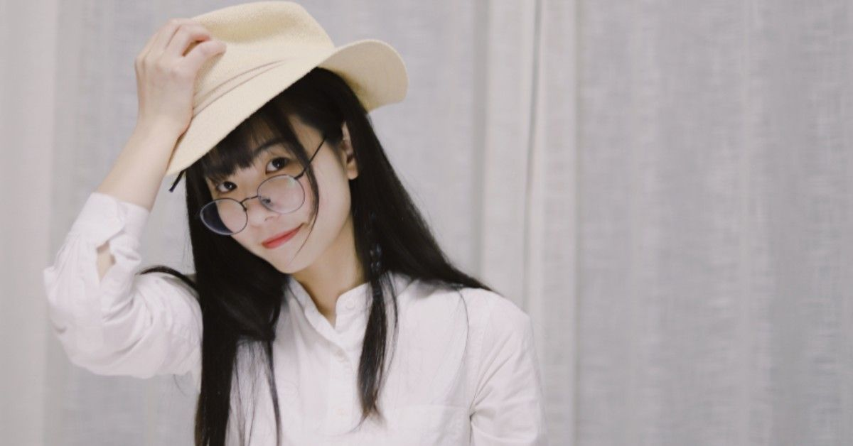 image of girl with bangs and glasses wearing a hat