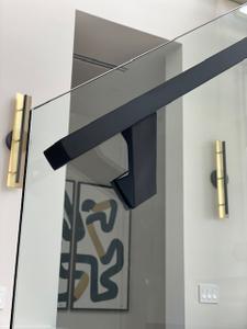 Black glass-mounted handrail bracket