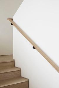 Modern-handrail-on-a-white-wall