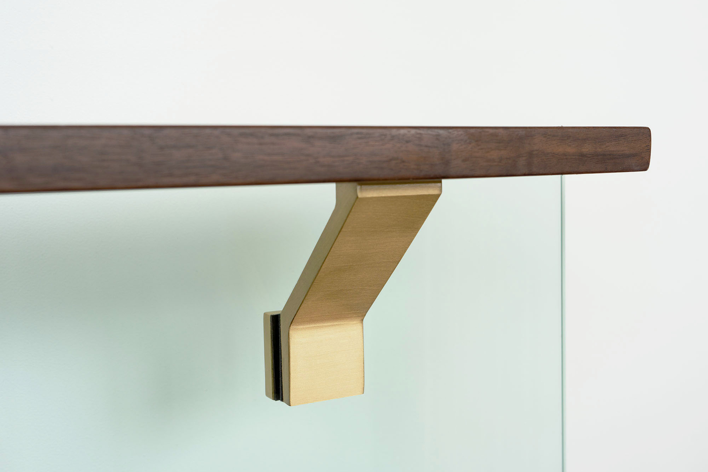 Contemporary-glass-mounted-brass-handrail-bracket