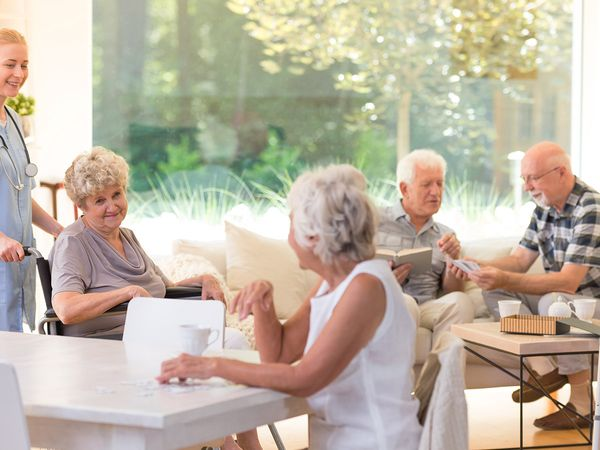 image of group of senior citizens hanging out at an assisted living facility
