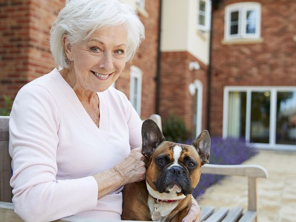 image of an elderly woman with her dog at an assisted living facility