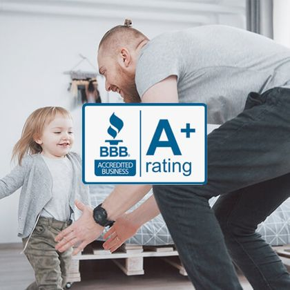 A dad and daughter having fun, along with the BBB A+ Badge