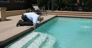 how-to-clean-your-pool-featured-image-5e33557f0d648-300x157.jpg
