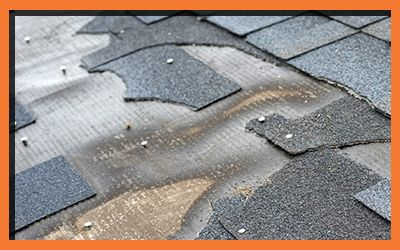 Image of a roof missing shingles