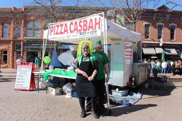 two people in customs in front of Pizza Casbah booth