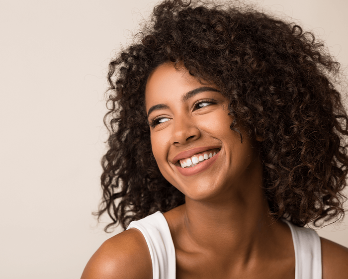 black woman looking right and smiling