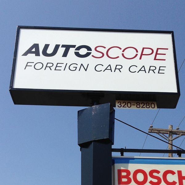 Cabinet sign for AutoScope mounted on top of a pole.