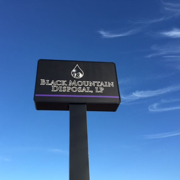 Black Mountain Disposal cabinet sign mounted on a pole.