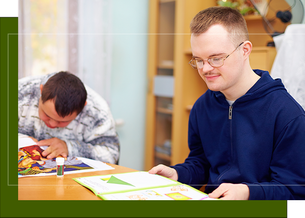 image of a developmentally disabled man reading