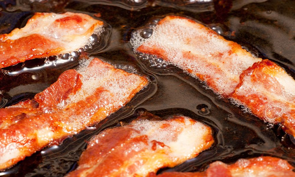 bacon cooking in bacon fat