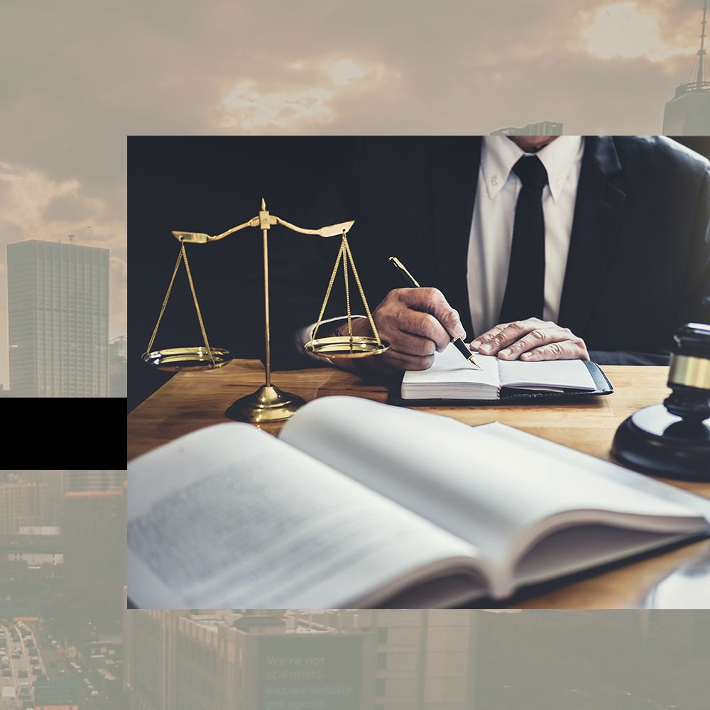 lawyer writing in notebook