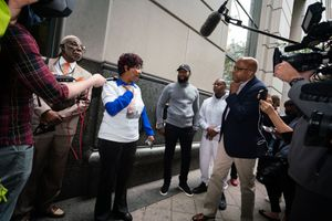 3. Eric Riddick_s mother answering questions outside the Criminal Court.jpg