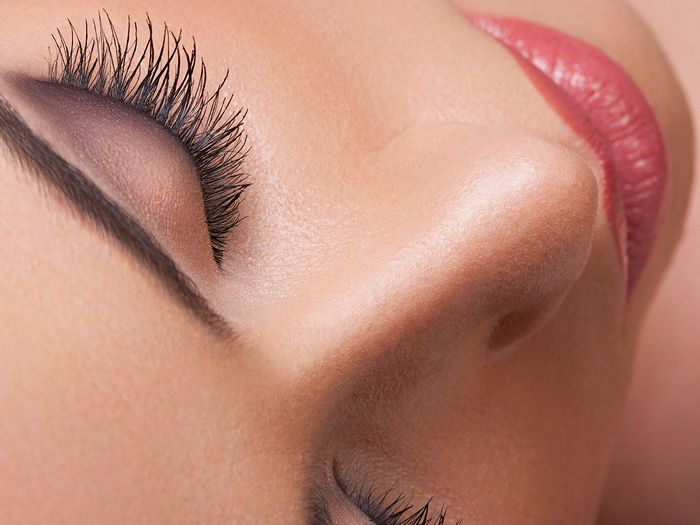 Close-up image of a woman's face, brows, and lips.