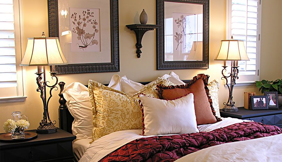 Image of white shutters in a bedroom with light yellow walls
