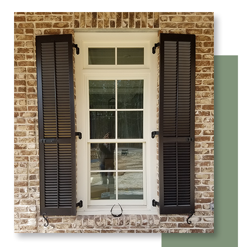 Image of a window with exterior plantation shutters.