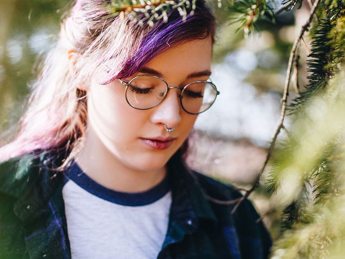 girl with purple hair in woods