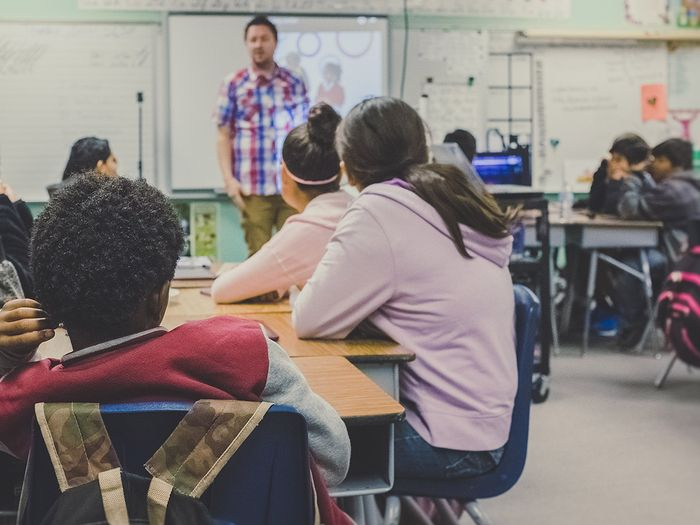 image of a man teaching a group of middle schoolers