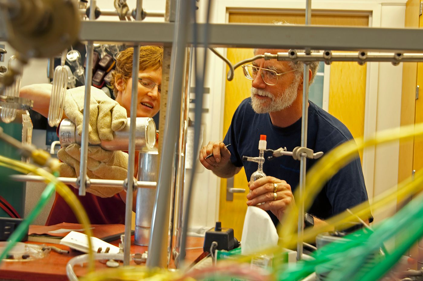Student and instructor work on experiment at the School of Oceanography