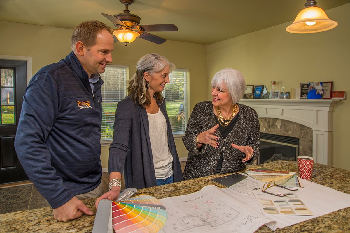 Transitional Marketing Specialist Nancy Werner works with the staff at Tenhulzen Construction.