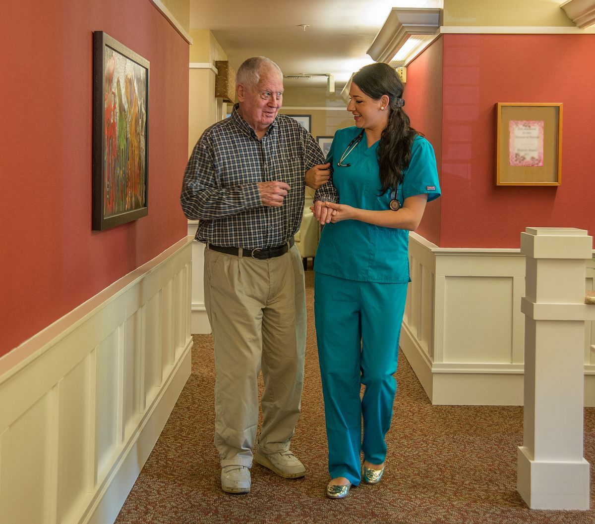 Rosewood Courte resident takes a walk around the facility with his nurse.