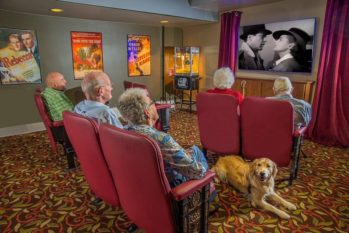 Resident enjoy the movies at Liberty Shores Senior Living