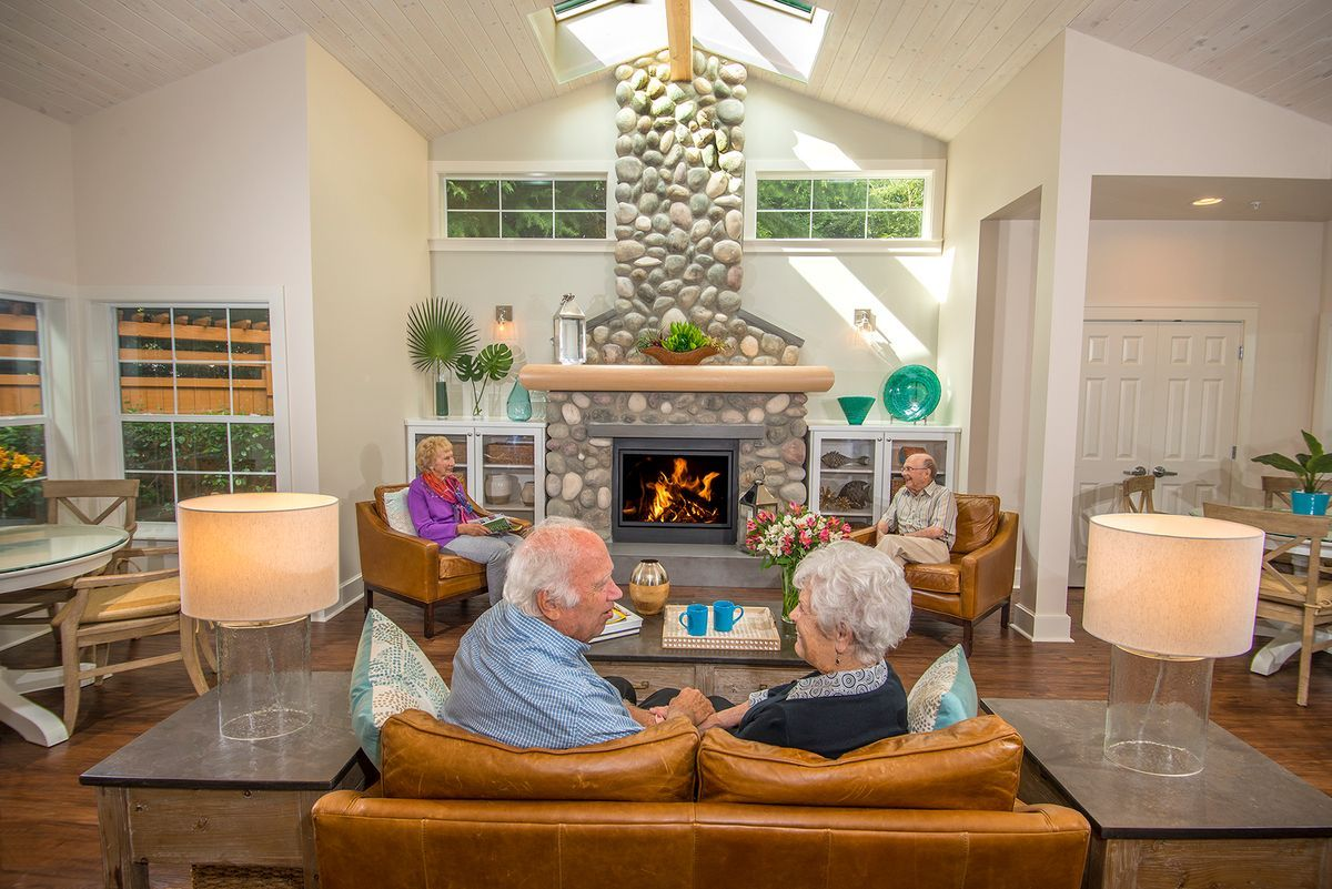 Residents chat in the large community room at  Rosewood Courte Senior Living