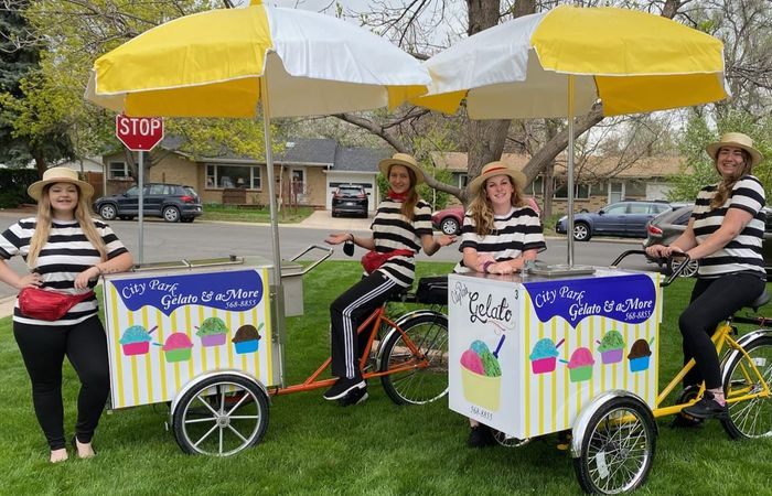 Gelato & aMore employees posing for photo on gelato cart in Fort Collins