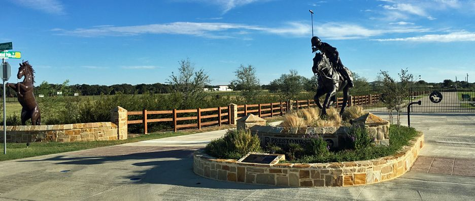Statue of man on horse playing polo
