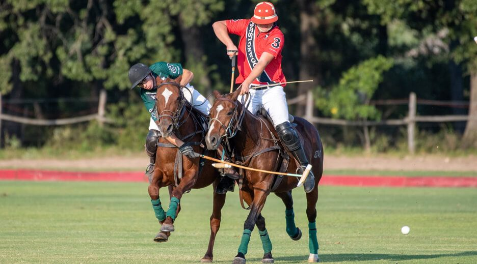 Two people playing polo