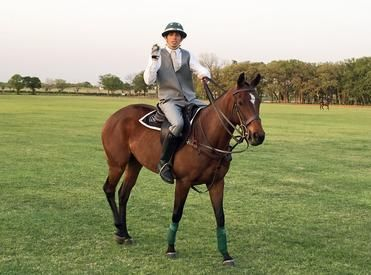 man in suit on horse
