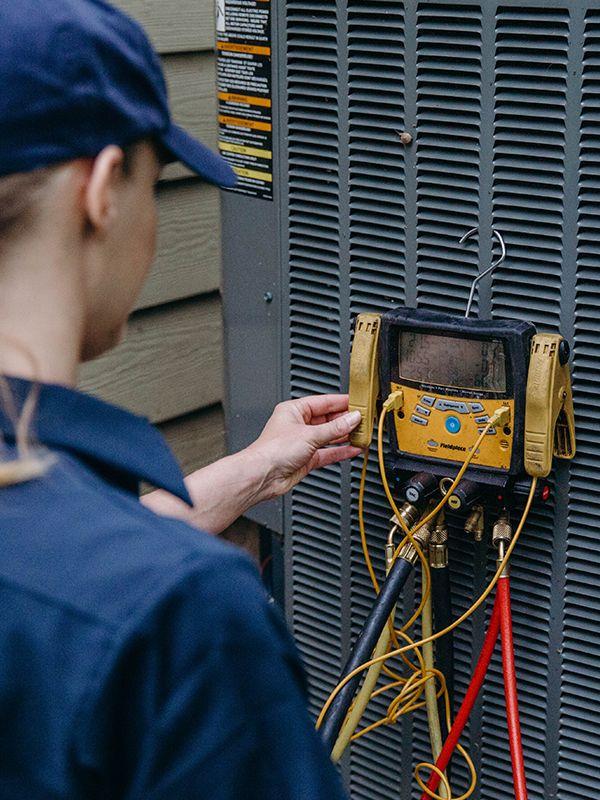 Temperature Pro Employee repairing AC