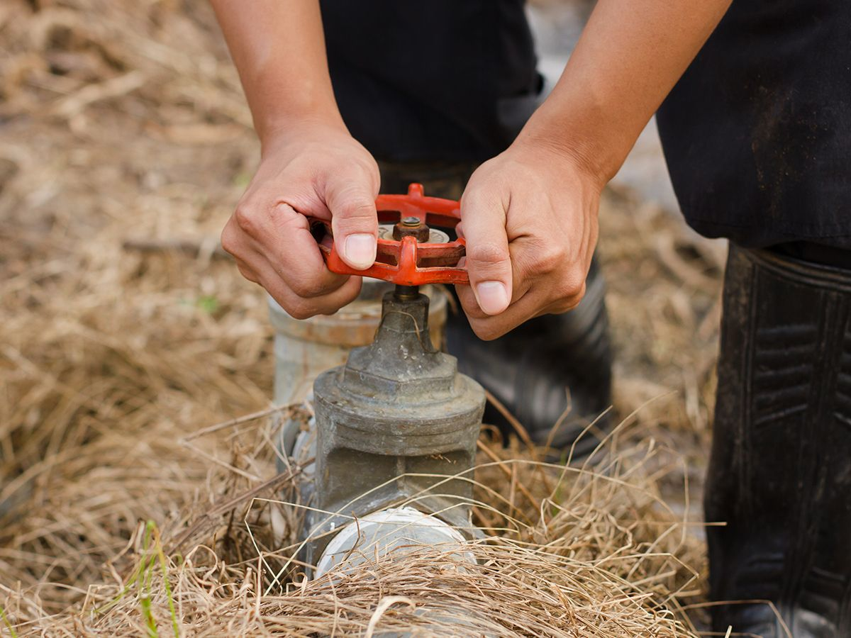 Image of a contractor performing maintenance on an irrigation system.