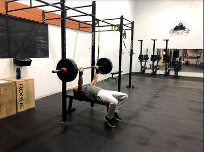 man lifting weights.jpg
