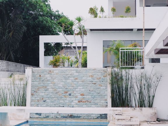 Backyard pool with old stonework.