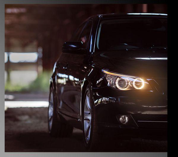 A close up shot of the headlights of a nice BMW sedan.