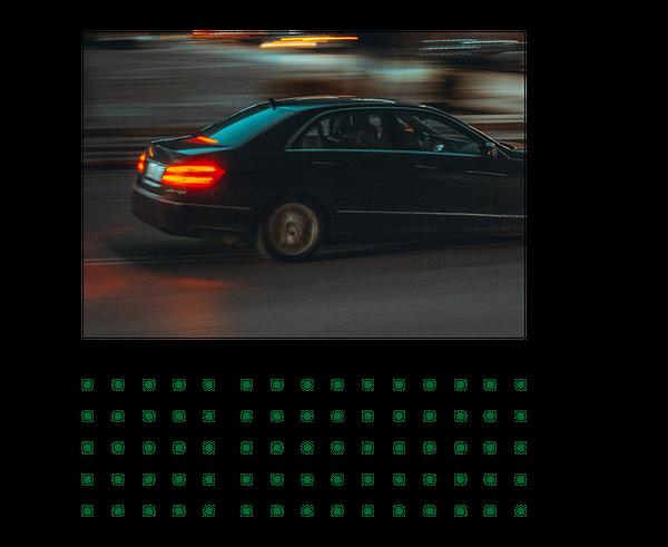 Car driving in street