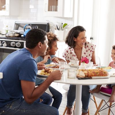 Tag: An image of a family eating dinner together.