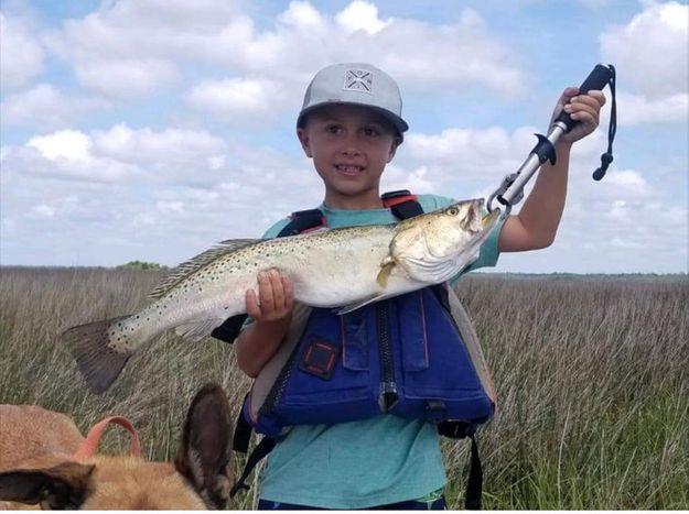 child holding large fish