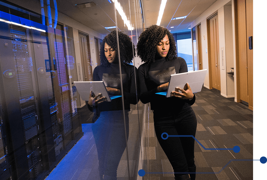 Woman leaning against glass wall of data center