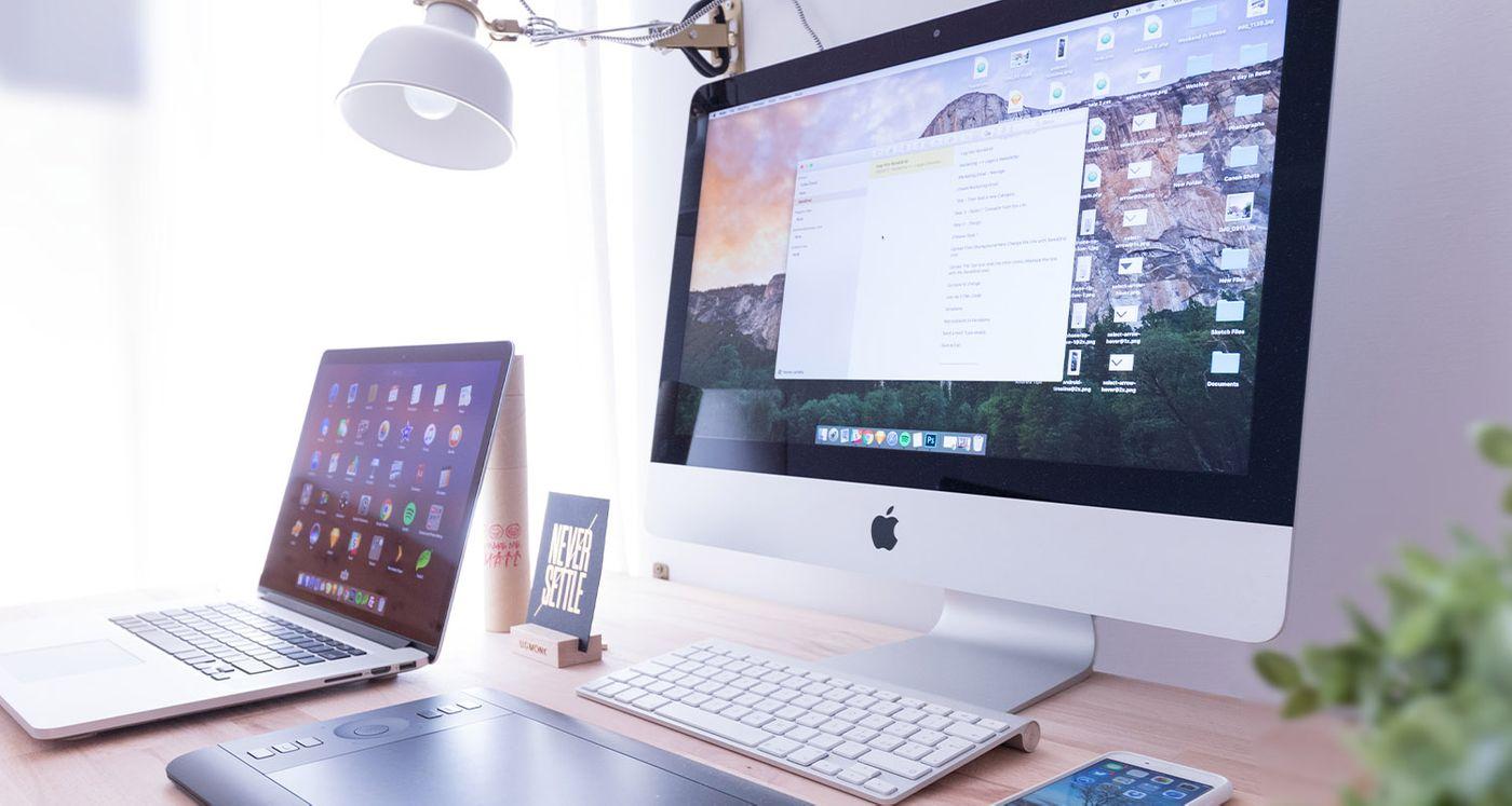 Mac computer, lap top and iPhone