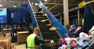 Image of recycling being sorted on a conveyer belt.