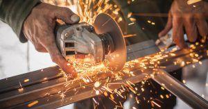 Image of a man cutting metal