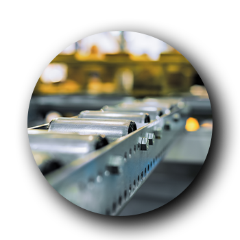 a close up image of conveyor belt rollers