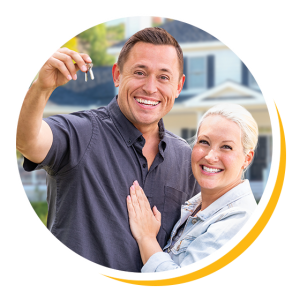 Image of happy couple smiling with keys