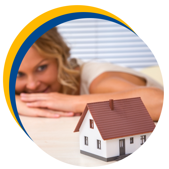 Image of a woman looking at a house model