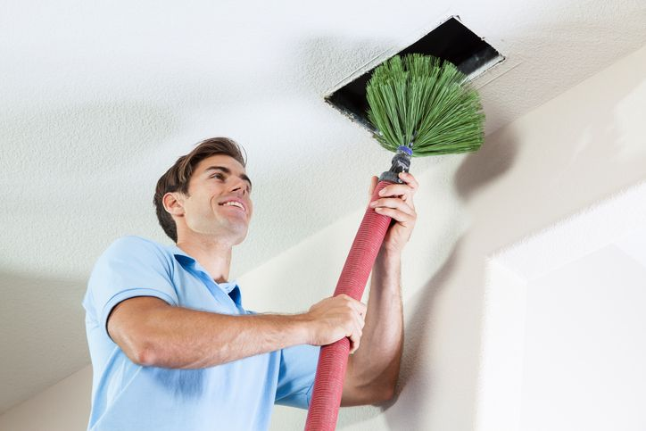 cleaning ceiling duct.jpg