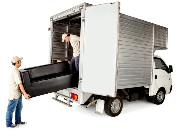 Delivery men loading a sofa in a truck - isolated over white.jpg