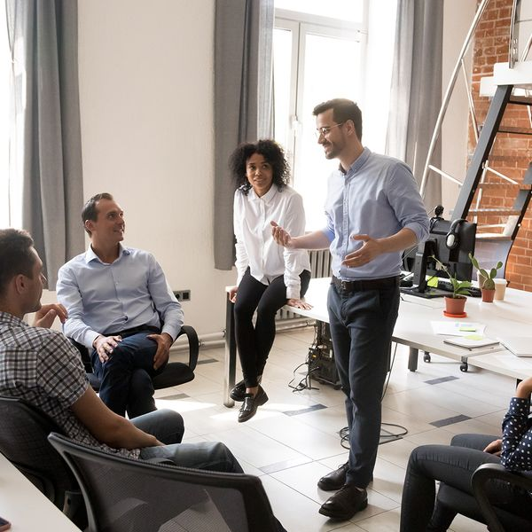image of a group of people having a discussion in an office